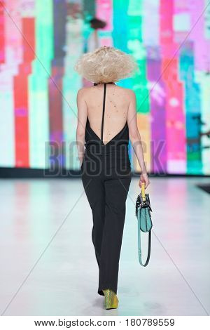 ZAGREB, CROATIA - APRIL 01, 2017: Fashion model wears clothes designed by Marina Design and a bag designed by Marija Ivankovic at the 'Fashion.hr' fashion show