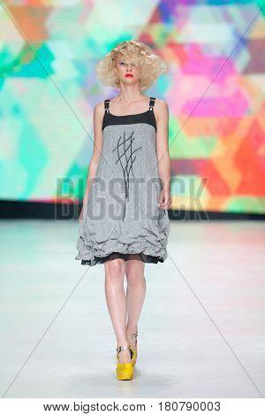 ZAGREB, CROATIA - APRIL 01, 2017: Fashion model wearing clothes designed by Marina Design at the 'Fashion.hr' fashion show