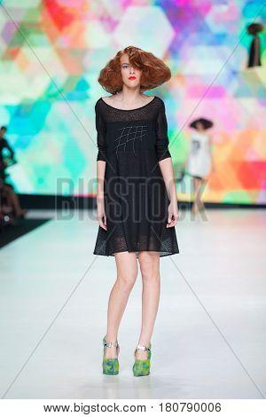 ZAGREB, CROATIA - APRIL 01, 2017: Fashion model wearing clothes designed by Marina Design on the 'Fashion.hr' fashion show