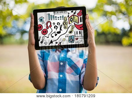 Digital composite of Kid holding tablet over face showing music doodles and white background