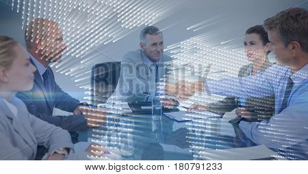 Digital composite of Business meeting with behind blue map graphic overlay against grey background