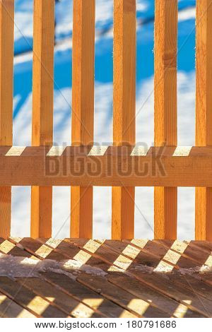 Wooden picket fence as abstract winter background