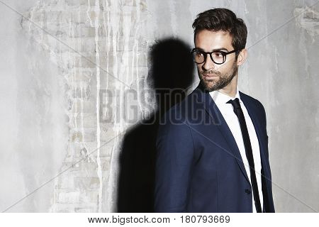 Cool Business suit man looking away studio