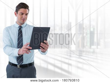 Digital composite of Businessman with tablet in futuristic bright room