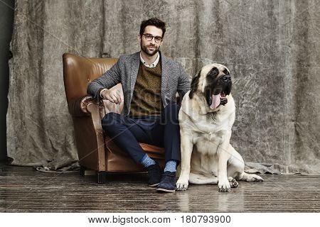 Guy and dog in studio portrait studio