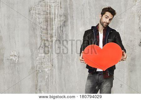 Heart shape held by Valentine guy in love