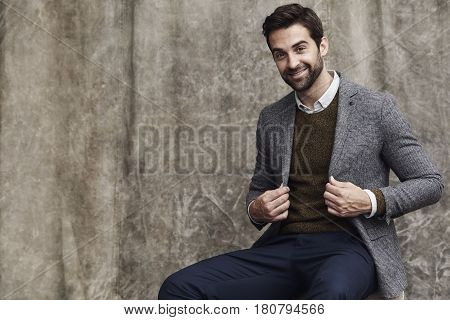 Handsome Jacket guy sitting in studio portrait