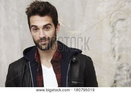 Handsome Stubble dude in leather jacket portrait