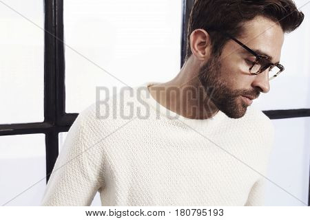 Dude in profile in white sweater studio
