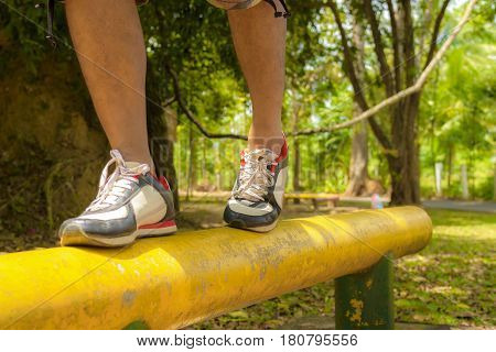 Body part,Feet of men with exercising in public park.Concept of health.Zoom in