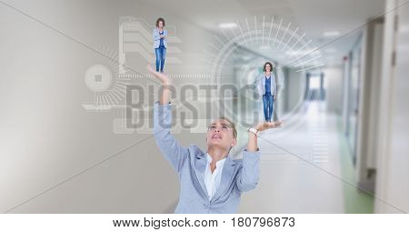 Digital composite of Digital composite image of businesswoman holding executives in hands with symbols