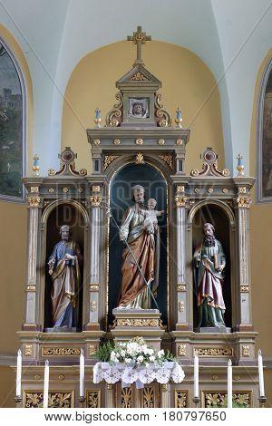 SISLJAVIC, CROATIA - AUGUST 23: Main altar in the Parish Church of Saint Joseph in Sisljavic, Croatia on August 23, 2011.