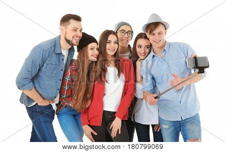Happy young friends taking selfie on white background
