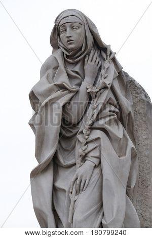 ROME, ITALY - SEPTEMBER 05: Statue of Saint Catherine of Siena near Sant Angelo Castle in Rome, Italy on September 05, 2016.