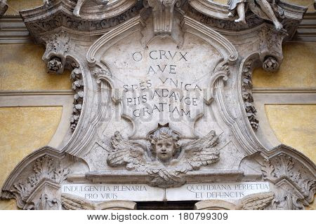 ROME, ITALY - SEPTEMBER 05: Angels and epigraph: Hail, the only hope, add more grace to the pious, facade of Santa Maria Maddalena Church in Rome, Italy on September 05, 2016.