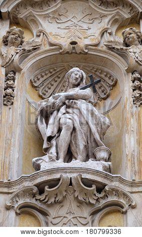 ROME, ITALY - SEPTEMBER 05: Statue of Saint Mary Magdalen on facade of Santa Maria Maddalena Church in Rome, Italy on September 05, 2016.