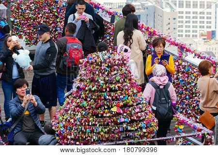 Seoul, South Korea - April 1, 2017: Love padlocks at Seoul's N Tower with a slight overview over the city's skyline. located on Namsan Mountain in central Seoul, South Korea.