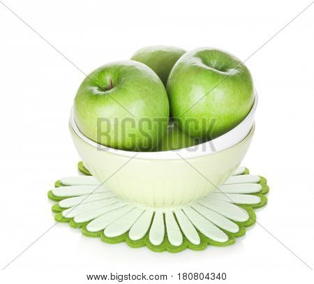 Green apples in fruit bowl. Isolated on white background