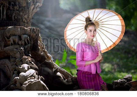 Lao woman in national uniform Lao woman in national costume holding umbrellas