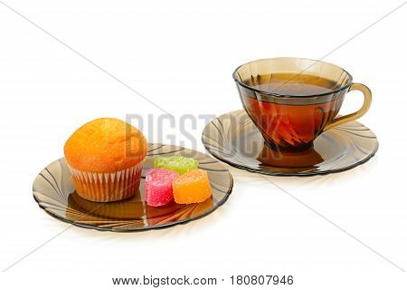 Cup of tea cupcake and marmalade isolated on white background