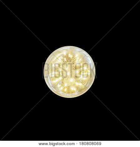 Closeup opening light bulb with yellow light isolated on black background