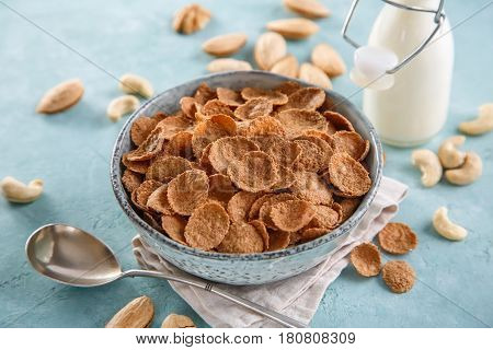 Wheat bran breakfast cereal with milk and nuts. Healthy Breakfast