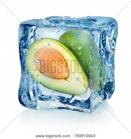 Mango in ice cube isolated on a white background