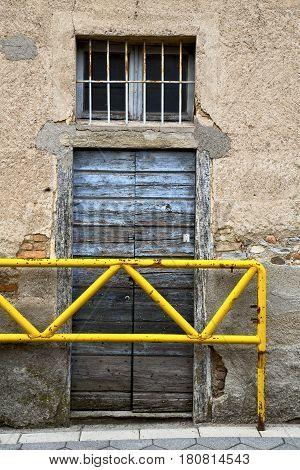 Brown Door          The Milano Old   Window Closed Brick Terrace