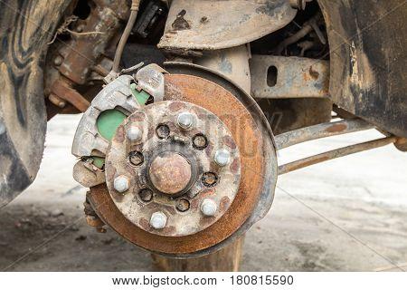 Old disk brake repair in the garage, mini-truck
