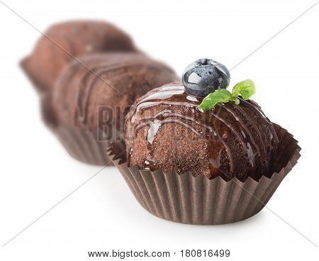Three chocolate cakes isolated on a white background