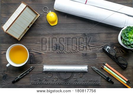Architects workplace with constructor tools with cup of tea and glasses on wooden table background top view mockup