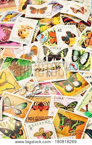 Collection of postage stamps with various butterflies