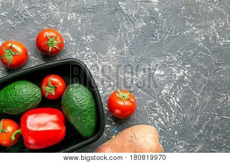 Store concept with vegetables and plastic tray on gray table background top view mockup