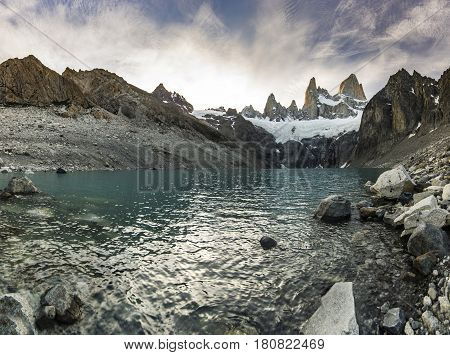 towers of Fitz Roy mountain and lake lago sucia at sunset