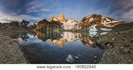 towers of Fitz Roy mountain and lake lago de los tres at red sunrise