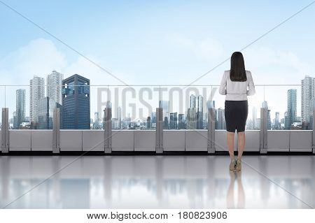 Portrait Of Asian Business Woman Standing On A Terrace