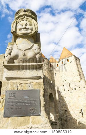 Carcassonne, France - October 20, 2016; The replica of lady Carcas's bust above World heritage Site brass plaque at entrance to castle or fort known as La Cite de Carcassonne France