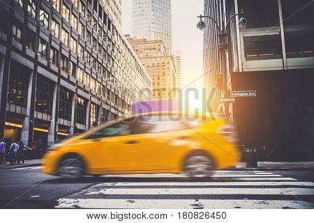 A cab driving on the streets of New York City