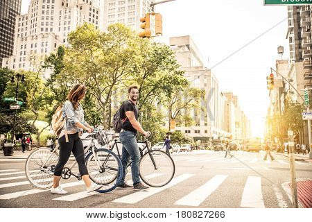 Couple of cyclist in New York - Couple of lovers sighseeing Manhattan on bikes