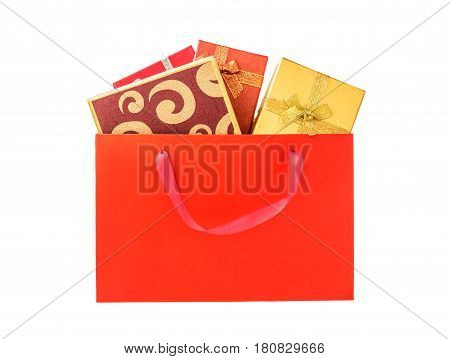 Gift boxes in shopping bag isolated on white background