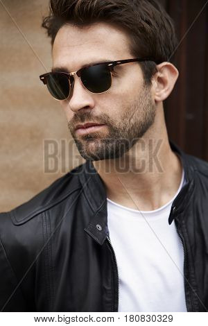 Handsome Cool dude in sunglasses and stubble