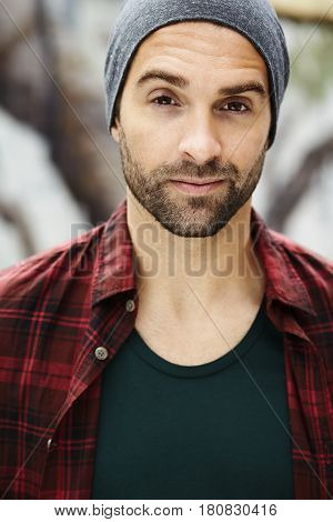 Dude in hat and checked shirt portrait