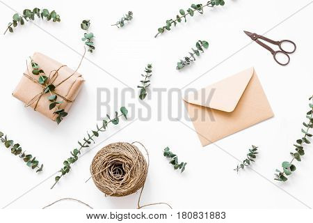 homemade gift wraped in box composition for birthday celebration on white desk background top view