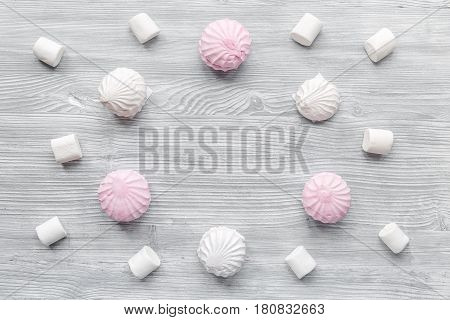 woman breakfast with sweet marsh-mallow on light wooden table background top view mock up