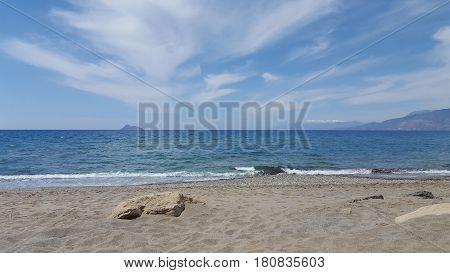 Ocean, coast and cloudy sky in Crete