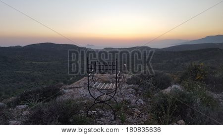 Chair overlooking the countyside and coast, Crete