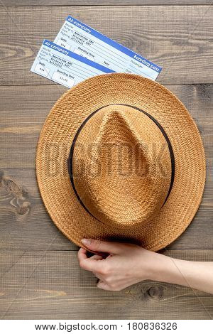 journey planning with tourist outfit and tickets and hat on wooden table background top view