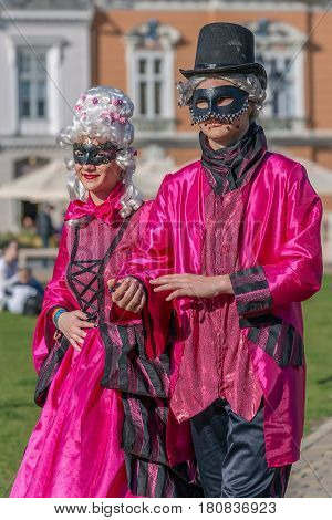 TIMISOARA ROMANIA - MARCH 31 2017: Couple dressed in period costumes and present on the street inside the CheckART Carnival organized by the City Hall Timisoara.