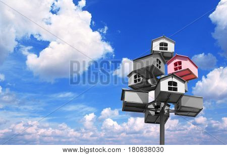 Many nesting boxes of gray color and single nesting box of pink color. On background with blue sky and white clouds
