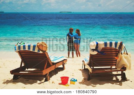 happy couple relax on tropical beach vacation